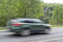 Closeup shot of a car in motion royalty free stock photos