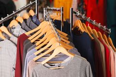 Closeup shot of clothes hang on a shelf Royalty Free Stock Image