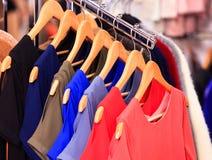 Closeup shot of clothes hang on a shelf Stock Images