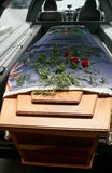 A colorful casket in a hearse or chapel before funeral or burial at cemetery. Closeup shot of a colorful casket in a hearse or chapel before funeral or burial at royalty free stock photography