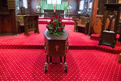A colorful casket in a hearse or chapel before funeral or burial at cemetery. Closeup shot of a colorful casket in a hearse or chapel before funeral or burial at royalty free stock image