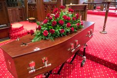 A colorful casket in a hearse or chapel before funeral or burial at cemetery. Closeup shot of a colorful casket in a hearse or chapel before funeral or burial at stock photography