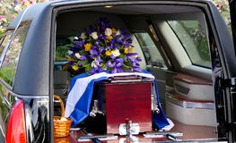 Shot of a colorful casket in a hearse or chapel before funeral or burial at cemetery Royalty Free Stock Photos