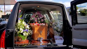 Shot of a colorful casket in a hearse or chapel before funeral or burial at cemetery. Closeup shot of a colorful casket in a hearse or chapel before funeral or stock video footage