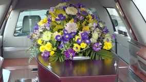 Closeup shot of a colorful casket in a hearse or chapel before funeral or burial at cemetery. N stock footage