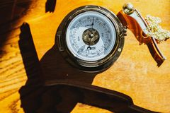 Compass on a yellow surface royalty free stock photography