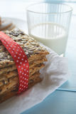 Closeup shot of cookies and milk glass Royalty Free Stock Image
