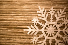 Closeup shot of decorative white show flake on wooden board royalty free stock image