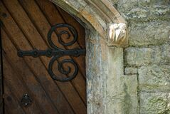 Closeup shot of a door and stonework on a vault in Nunhead cemetery, in London, England