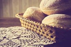 Closeup shot of doughnuts in wicker basket vintage effect Stock Image