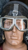 Closeup shot of dummy man head with old vintage retro pilot leather helmet and goggles. Closeup shot of dummy man head with old vintage retro aircraft pilot Stock Photos