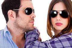 Closeup shot of fashion models wearing sunglasses. On a isolated background Stock Photo