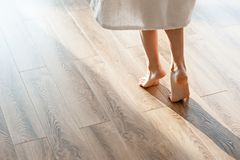 Closeup shot of female feet under bed at morning royalty free stock photo