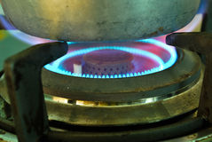 Closeup shot of fire, gas kitchen stove. Royalty Free Stock Image