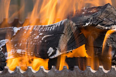 Closeup shot of fire wood coil in bbq. Closeup shot of fire wood coil in grill bbq barbecue Royalty Free Stock Image