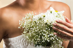 Closeup shot of flower bouquet held by a bride Stock Photo
