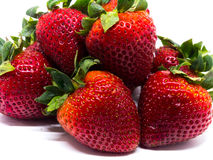 Closeup shot of fresh strawberries. Isolated on white background Stock Photography