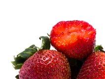 Closeup shot of fresh strawberries. Isolated on white background Royalty Free Stock Image
