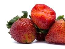 Closeup shot of fresh strawberries. Isolated on white background Stock Photos