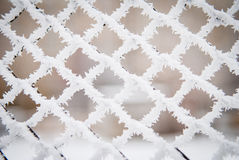 Closeup shot of frost and snow on a fence  Stock Photos