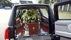 Funeral casket in a hearse or chapel or burial at cemetery. Closeup shot of a funeral casket in a hearse or chapel or burial at cemetery stock video footage