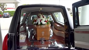 Funeral casket in a hearse or chapel or burial at cemetery. Closeup shot of a funeral casket in a hearse or chapel or burial at cemetery stock video