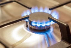 Closeup Shot of Gas Burner on Stove Surface. Stock Photo