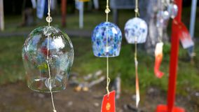 Shot of glass wind chimes on tengu mountain at otaru, hokkaido, japan. Closeup shot of glass wind chimes on tengu mountain at otaru, hokkaido, japan stock footage