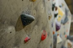 Closeup shot of grips for hands on a climbing wall stock photography