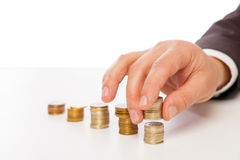 Closeup shot of hands counting coins over white Royalty Free Stock Photos
