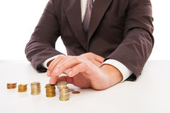 Closeup shot of hands counting coins over white Stock Photography