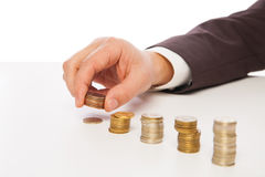 Closeup shot of hands counting coins over white Royalty Free Stock Photography