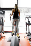 Closeup shot of legs of a female using elliptical trainer Stock Photography