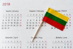 Lithuania flag pin on a calendar, Independence day anniversary concept February 16th. Closeup shot of Lithuania flag pin on a calendar, Independence day concept Royalty Free Stock Photography
