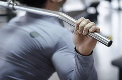Closeup shot of male hand holding pulldown machine handle, workout in the gym. Stock footage Royalty Free Stock Images
