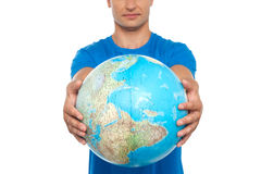 Closeup shot of man holding globe Royalty Free Stock Photo
