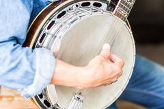 Man playing a banjo. royalty free stock photos