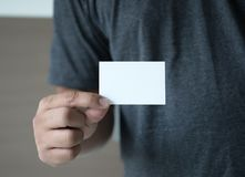 Closeup shot  Man show white business card Plastic bank-card des. Ign mock up Royalty Free Stock Photo
