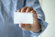 Closeup shot  Man show white business card Plastic bank-card des. Ign mock up Stock Image