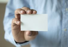 Closeup shot man show white business card plastic bank-card des. Ign mock up Stock Photo