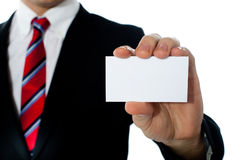Closeup shot of a man showing business card. Copysapce area Royalty Free Stock Photos