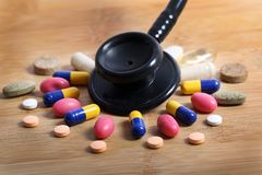 Medicine and treatment. Closeup shot of medicine capsule and pills Royalty Free Stock Image