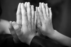 Closeup shot of men and women hands touching mirror Royalty Free Stock Images