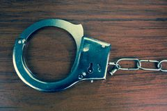 Closeup shot of metallic handcuffs Stock Photos