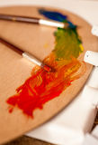 Closeup shot of mixed oil paints on wooden palette Stock Photography
