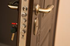 Closeup shot of modern door lock with a key. Empty space. Closeup shot of modern door lock with a key. Space for text Stock Photo