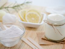 Closeup shot of natural skincare product ingredients: lemon, baking soda, and yogurt