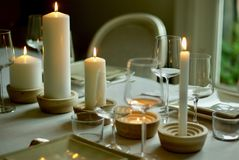Closeup Shot Of A Dinner Table With Wine Glasses And Candles With A Blurred Background Stock Photo