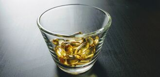 Free Closeup Shot Of Yellow Drugs Bunch- Perfect For Omega-3, Fish Oil Concepts Royalty Free Stock Image - 186627336