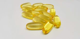 Free Closeup Shot Of Yellow Drugs Bunch- Perfect For Omega-3, Fish Oil Concepts Royalty Free Stock Image - 186627356